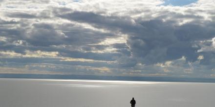Figure looking across lake